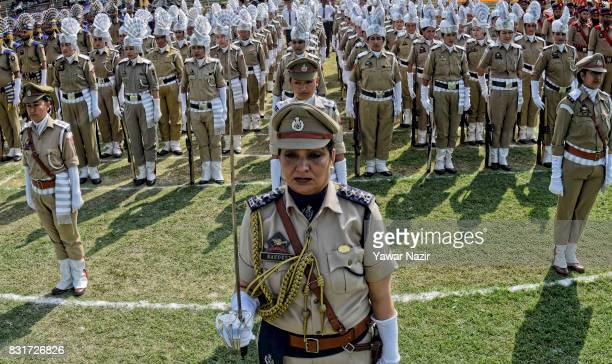 A contingent of Indian police women stand in formation before their parade at Bakshi Stadium where the authorities hold the main function during...