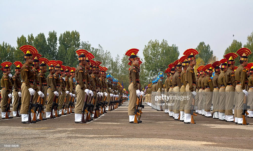 A contingent of Indian policemen stand in formation during a ceremony on police Commemoration Day on October 21, 2012, in Zewan, on the outskirts of Srinagar, the summer capital of Indian administered Kashmir, India.To pay homage to the slain Indian policemen and security forces killed in the militant attacks in the strife- torn region of Kashmir during the last two decades, the annual Police Commemoration Day is observed to remember on 21 of October .