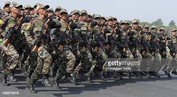 Contingent of Naga Regiment of Indian Army march past during 65th Territorial Army Raising Day Parade on October 9 2014 in New Delhi India The...