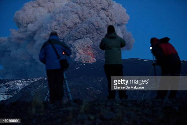 Continuing activity of Eyjafjallajokull volcano attracts tourists and onlookers until late evening when lava's spewing can be seen glowing...