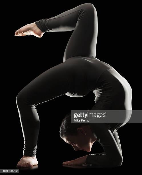 Contortionist bending over backwards