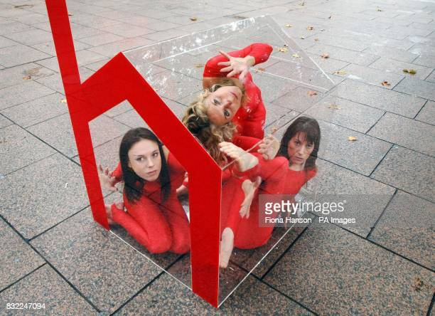 Contortionist family Michelle Laine who is cousin to sisters Delia Du Sol and Yvette Du Sol in a perspex house in London's Leciester Square as part...