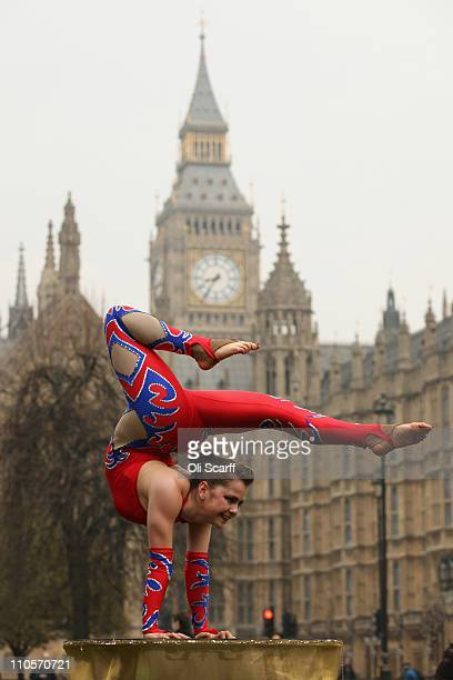 Contortionist Lowri Thomas poses for a photograph in front of the Houses of Parliament on March 22 2011 in London England The Association of Circus...