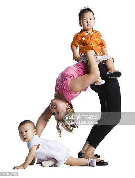 Contortionist mother with son and baby daughter