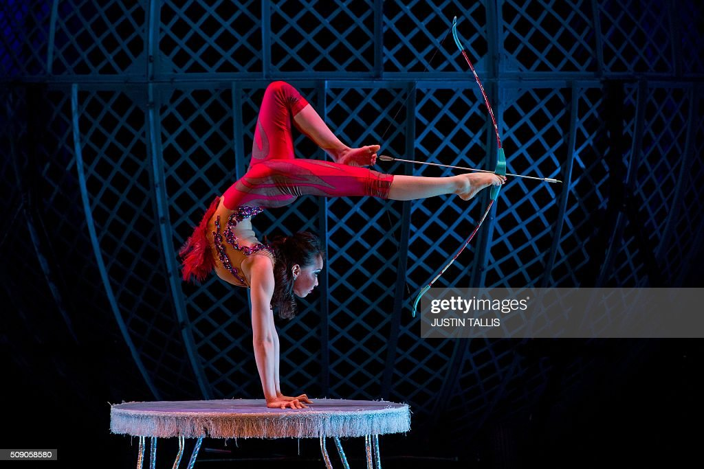 Contortionist Odka from Mongolia performs during a photocall to promote the forthcoming Zippos CIRQUE BERSERK! circus, at the Peacock Theatre in London on February 8, 2106. The sho is set to bring traditional circus skills to a West End theatre, and will run until February 24. / AFP / JUSTIN TALLIS