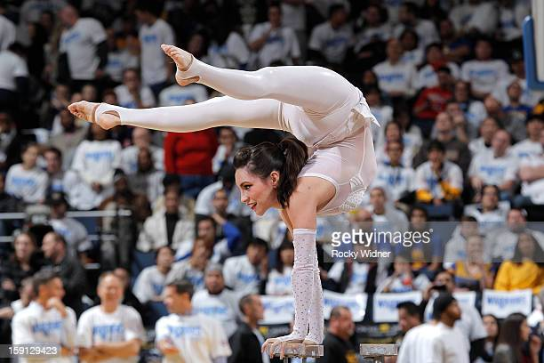 A contortionist preforms for the crowd during a game between the Los Angeles Clippers and the Golden State Warriors on January 2 2013 at Oracle Arena...