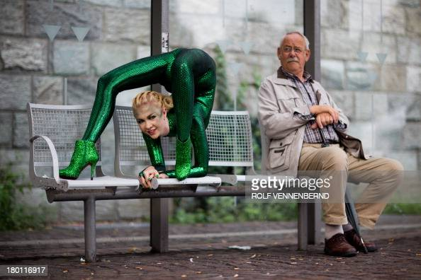 Contortionist Zlata performs on a bus stop on September 9 2013 in BergischGladbach western Germany to promote the International Contortionists'...