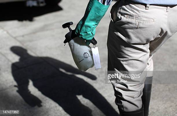 Contra Costa County Mosquito and Vector Control District technician David Wexler carries a container of BVA Larvacide Oil before spraying a catch...