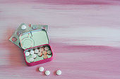 Contraceptive pills box with gender symbol on pink background