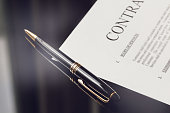 contract documents and fountain pen on black desk, business concepts