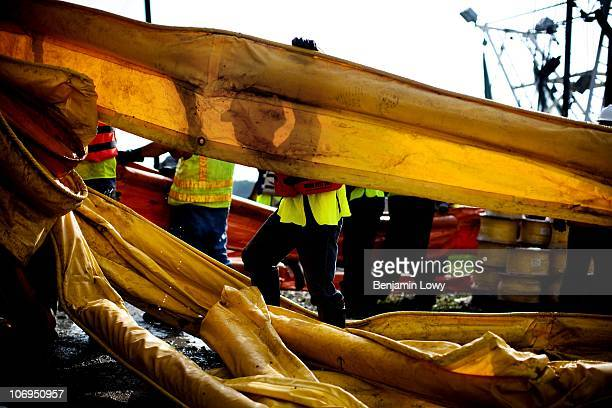 BP contract employees unload massive amounts of oil absorbent 'boom' at the BP cleanup operations center on May 4 2010 in Hopedale LA