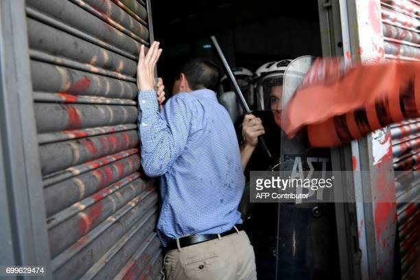 TOPSHOT Contract municipal workers try to enter the Greek Interior ministry in Athens during a protest on June 22 2017 Workers who are on strike...