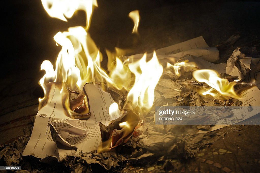A contract which commits students to work in Hungary after graduation is burned in Budapest on December 21, 2012. Protests over higher education reform in Hungary spread despite government efforts to appease students angry over cuts to study grants and new rules making them promise not to move abroad after graduation.