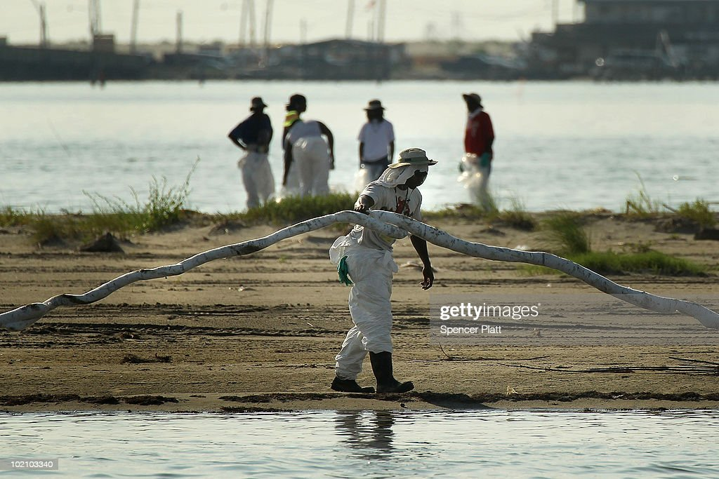A contract worker lifts up a piece of oil slick boom while working to clean oil from a beach June 15, 2010 in Grand Isle, Louisiana. The BP spill has been called the largest environmental disaster in American history. U.S. government scientists have estimated that the flow rate of oil gushing out of a ruptured Gulf of Mexico oil well may be as high 40,000 barrels per day. Following his fourth trip to the Gulf on Monday, President Barack Obama will address the nation in an Oval Office speech today on the situation in the Gulf.