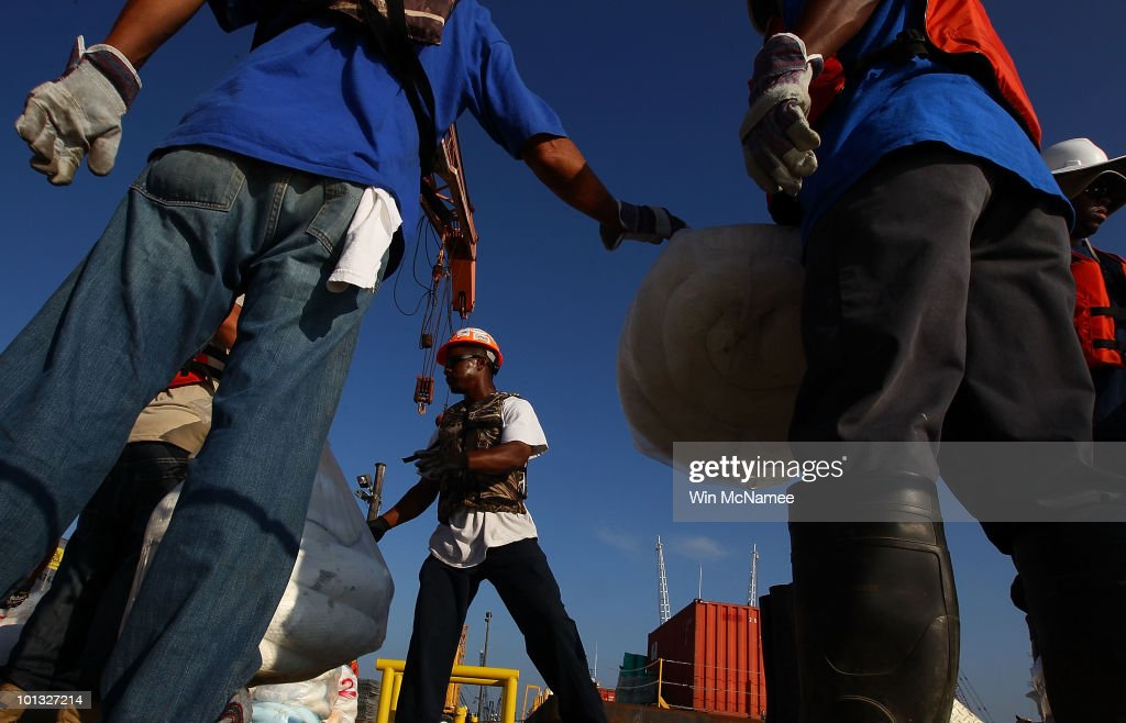 Contract workers from BP load absorbent booms onto a boat before departing from a staging area to clean up oil impacted marshes June 1, 2010 near Venice, Louisiana. Earlier in the day, U.S. President Barack Obama called the Deepwater Horizon accident the 'greatest environmental disaster of its kind in our history.'