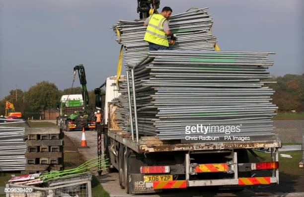 A contractor clears fencing from the Basildon Council operations site at Dale Farm travellers site following the completion of the clearance...