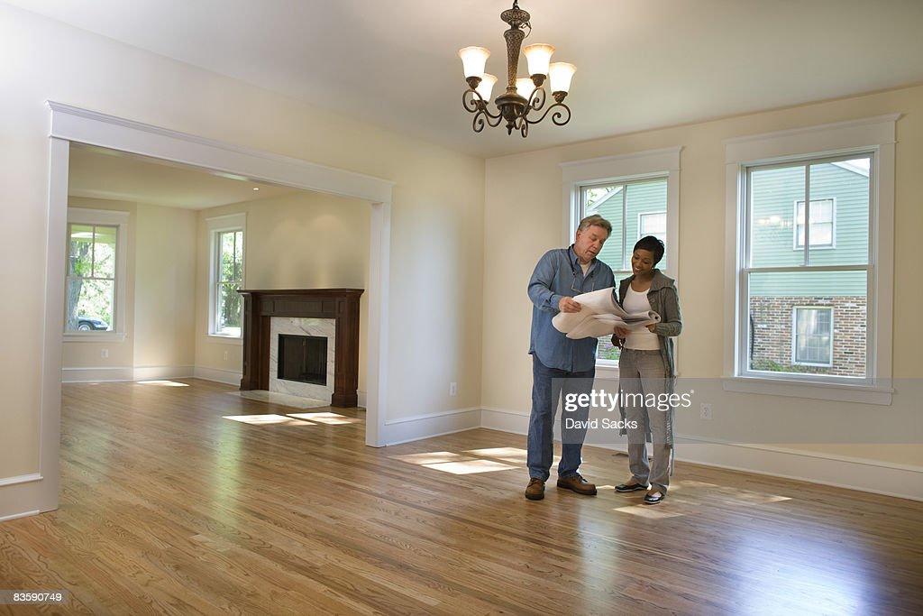 Contractor discussing renovations  : Stock Photo
