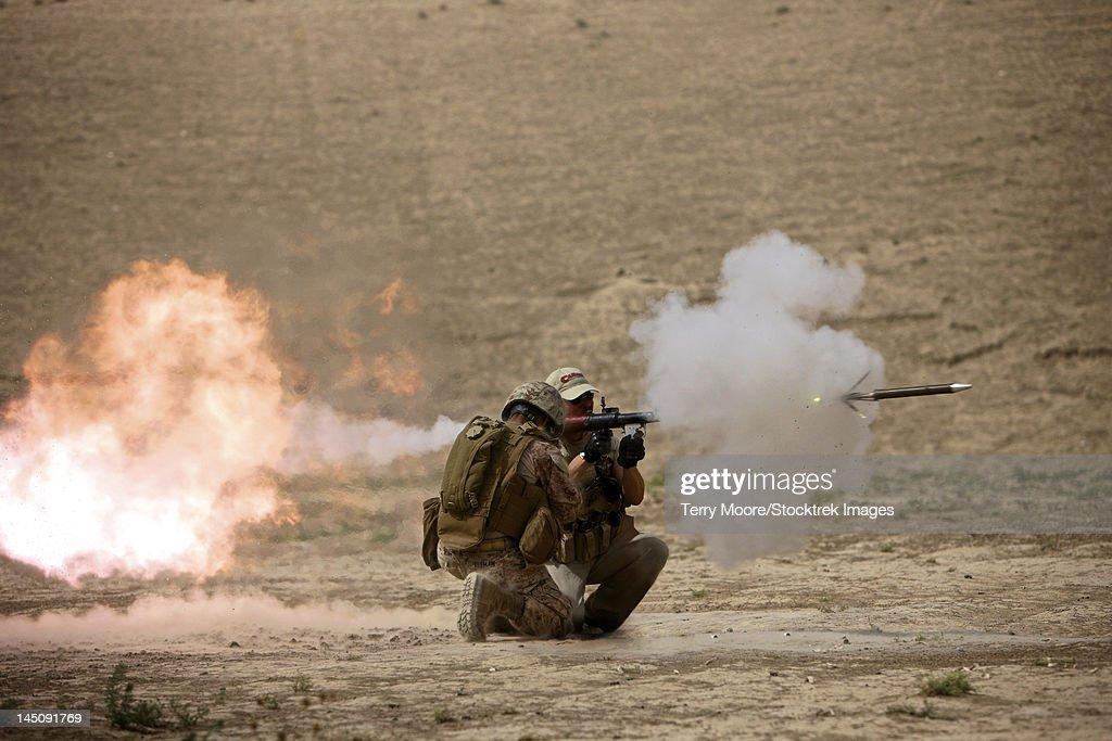 A U.S. Contractor fires a rocket-propelled grenade launcher.