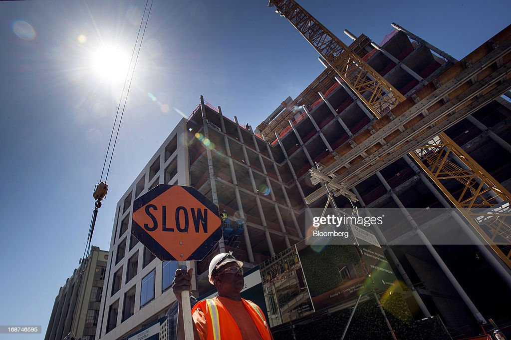 A contractor holds a 'Slow' sign at the 279,000 square foot Tishman Speyer Properties LP Foundry Square III construction site on Howard Street in San Francisco, California, U.S., on Wednesday, May 1, 2013. Leasing by San Francisco-area technology firms is slowing just as developers are poised to add 6.5 million square feet of office space to the city and Silicon Valley, the most construction in a dozen years. Photographer: David Paul Morris/Bloomberg via Getty Images