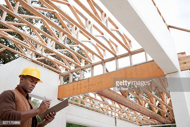 Contractor making notes at green building site
