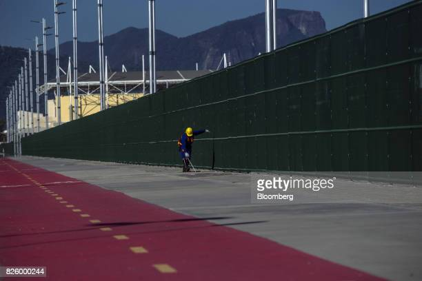 A contractor prepares the grounds outside Olympic Park ahead of a rock concert in the Barra da Tijuca neighborhood of Rio de Janeiro Brazil on...