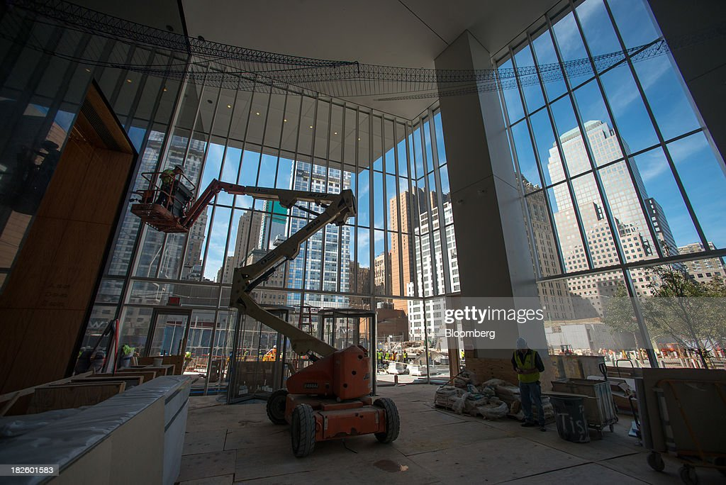 A contractor stands in a cherry picker while finishing construction on the 4 World Trade Center building, managed by Silverstein Properties Inc., in New York, U.S., on Wednesday, Sept. 25, 2013. Real estate developer Larry Silverstein cant recoup any of the $1.2 billion recovered by World Trade Center insurers in settlements with airlines and airport security companies over the Sept. 11, 2001, terrorist attack that destroyed the office complex, a judge ruled. Photographer: Craig Warga/Bloomberg via Getty Images