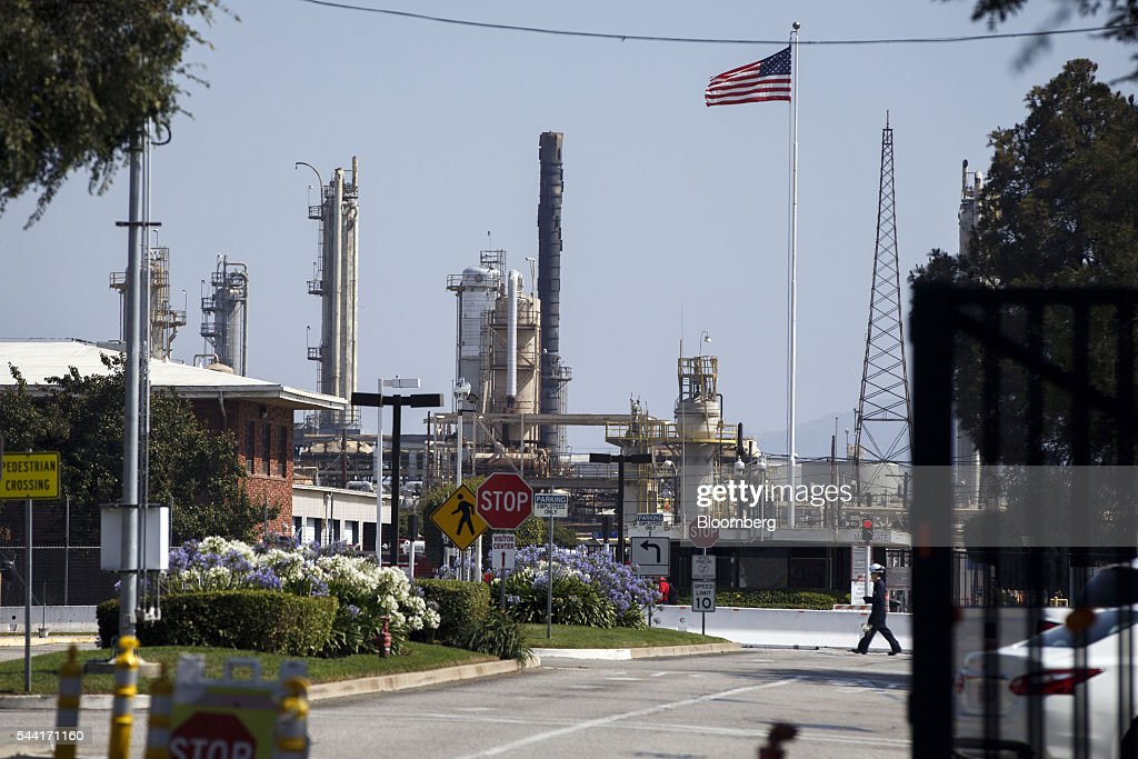 A contractor walks inside the Torrance Refining Co. oil refinery in Torrance, California, U.S., on Thursday, June 30, 2016. Exxon Mobil Corp. completed the sale of the Torrance refinery to PBF Energy on July 1. Photographer: Patrick T. Fallon/Bloomberg via Getty Images