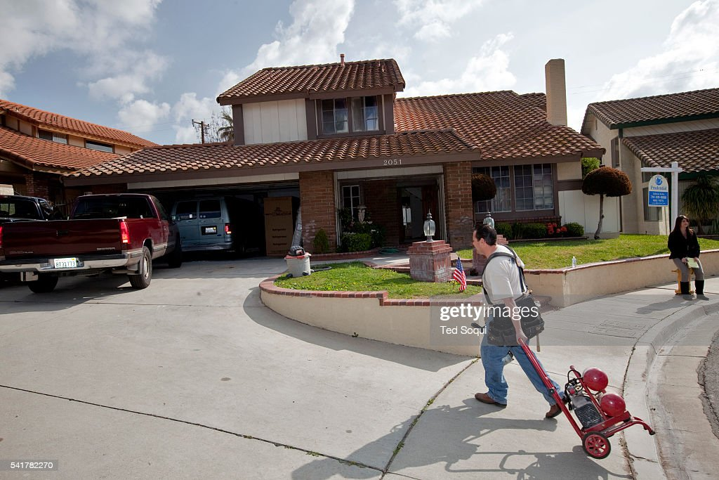 A contractor walks up the driveway of the new home for Nadia Suleman mother of octuplets and her family Her new La Habra home will have four bedrooms...