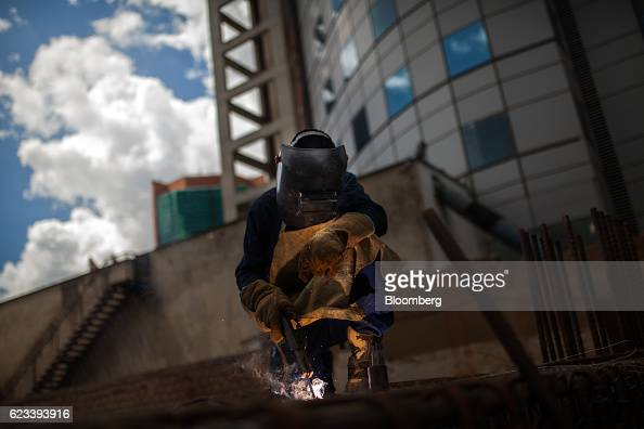 A contractor welds material while working on a building under construction in the El Rosal neighborhood of Caracas Venezuela on Wednesday Nov 9 2016...