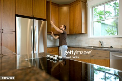 Contractor working on cabinets in new home stock photo for How to build a house without a contractor