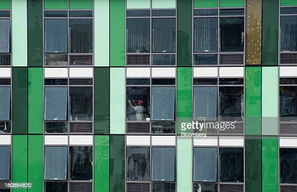 A contractor works on a condominium under construction in the borough of Brooklyn New York US on Monday Sept 16 2013 The US Census Bureau is...