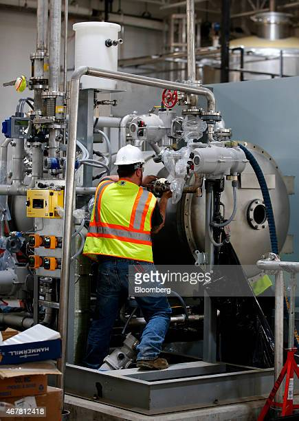 A contractor works on an ozone injection generator during construction of the Utah Valley Water Treatment Plant in Orem Utah US on March 19 2015 Upon...