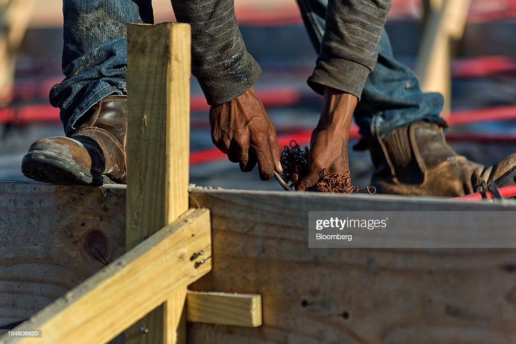 A contractor works on the foundation of a new home at the Cinnamon Shore beachfront community in Port Aransas, Texas, U.S., on Wednesday, Oct. 24, 2012. The U.S. Census Bureau is scheduled to release construction spending figures on Nov. 1. Photographer: Eddie Seal/Bloomberg via Getty Images