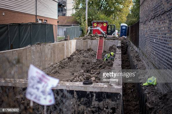A contractor works on the foundation of an apartment building under construction in Chicago Illinois US on Monday Oct 24 2016 The US Census Bureau is...
