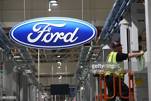 A contractor works on the yettobecompleted engine production line at a Ford factory on January 13 2015 in Dagenham England Originally opened in 1931...