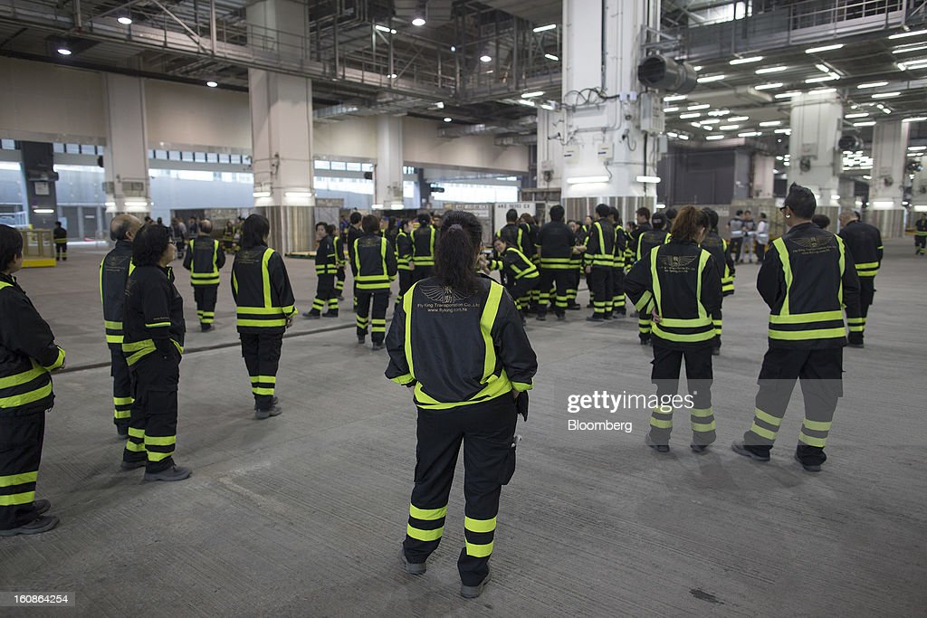 Contractors assemble during a training session in the Cathay Pacific Cargo Terminal in Hong Kong, China, on Monday, Feb. 4, 2013. Cathay Pacific Airways Ltd. aims to replicate its business-class strategy in a cargo trade upgrade. Photographer: Jerome Favre/Bloomberg via Getty Images