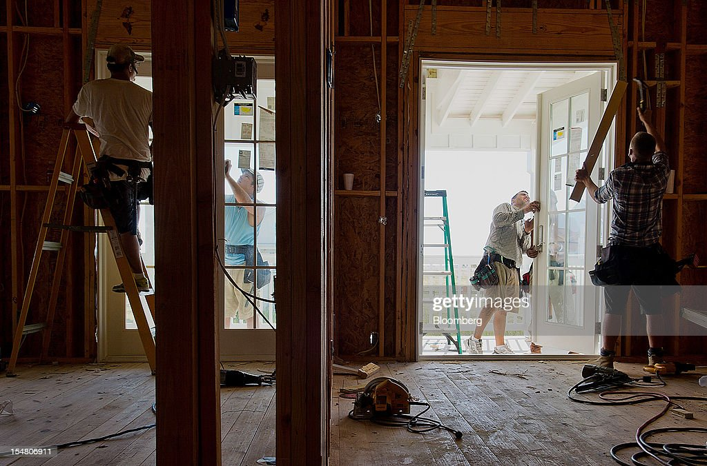 Contractors install doors on a new home at the Cinnamon Shore beachfront community in Port Aransas, Texas, U.S., on Wednesday, Oct. 24, 2012. The U.S. Census Bureau is scheduled to release construction spending figures on Nov. 1. Photographer: Eddie Seal/Bloomberg via Getty Images