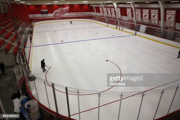Contractors paint a circle on the ice of the National Hockey League's Detroit Red Wings practice facility inside of the Little Caesars Arena during a...