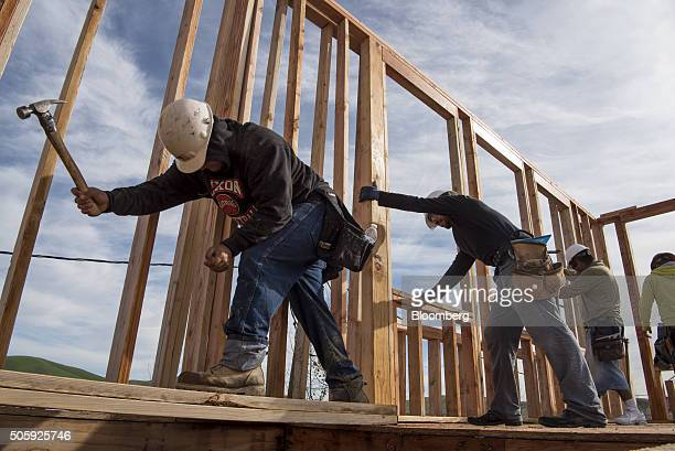 Contractors secure a wall section on a home under construction at the Toll Brothers Inc Cantera at Gale Ranch housing development in San Ramon...