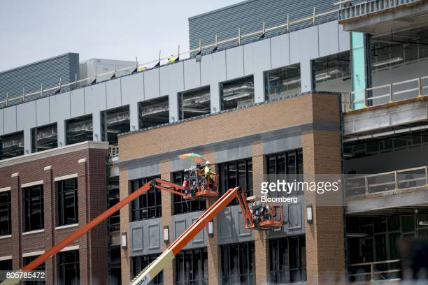 Contractors work on the exterior of the Little Caesars Arena in Detroit Michigan US on Thursday June 22 2017 To lure more young talent straight out...
