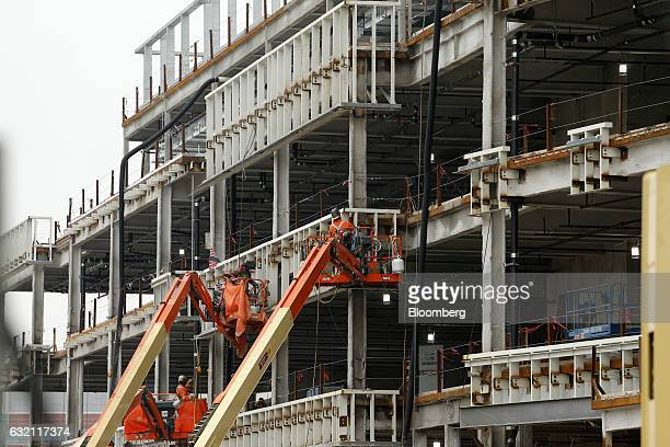 Contractors work on the facade of Little Caesars Arena under construction in Detroit Michigan US on Thursday Jan 19 2017 Detroit native and musician...