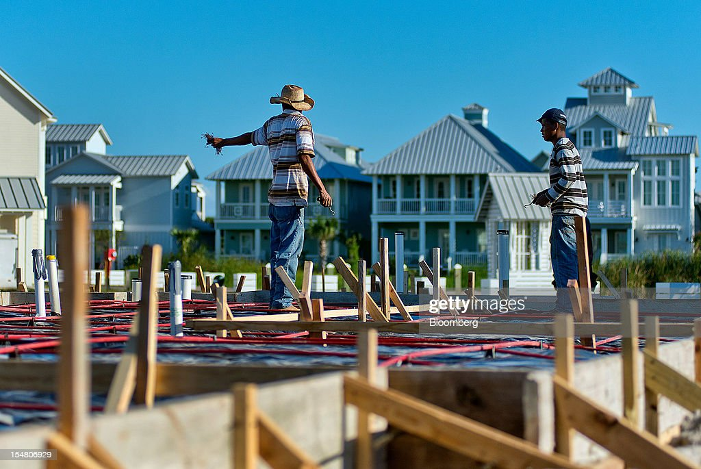 Contractors work on the foundation of a new home at the Cinnamon Shore beachfront community in Port Aransas, Texas, U.S., on Wednesday, Oct. 24, 2012. The U.S. Census Bureau is scheduled to release construction spending figures on Nov. 1. Photographer: Eddie Seal/Bloomberg via Getty Images