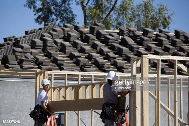 Contractors work on the frame of a home under construction at the DR Horton Express Homes Magma Ranch housing development in Florence Arizona US on...