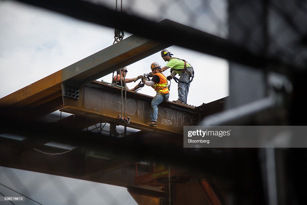 Contractors work on the Hudson Yards Culture Shed in New York, U.S., on Tuesday, May 31, 2016. The first skyscraper at Related Cos.'s $25 billion Hudson Yards project opened Tuesday after three and a half years of construction, bringing office workers to a once-desolate area of Manhattan's far west side that's now transforming into a new business enclave. Photographer: Michael Nagle/Bloomberg via Getty Images