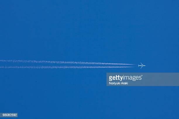 Contrail against blue sky
