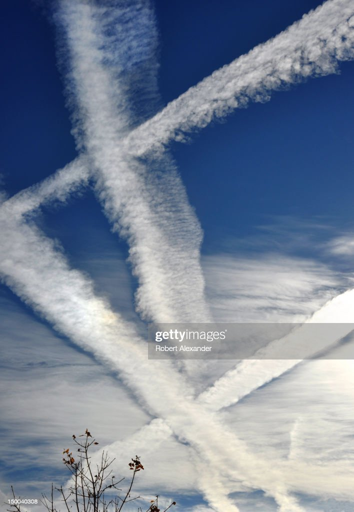 Contrails, or condensation trails, left by jet aircraft streak across the sky over Santa Fe, New Mexico. (Photo by Robert Alexander/Archive Photos/Getty Images) 5104602RA_NewMexico39.jpg