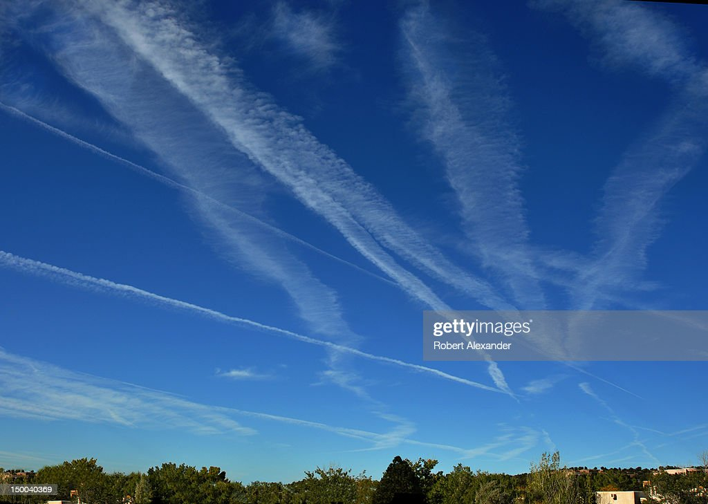 Contrails, or condensation trails, left by jet aircraft streak across the sky over Santa Fe, New Mexico. (Photo by Robert Alexander/Archive Photos/Getty Images) 5104602RA_NewMexico37.jpg