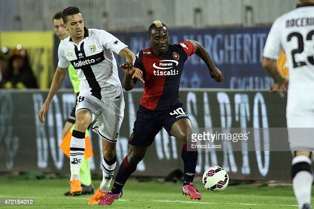 Contrast of M'Poku Paul Josè of Cagliari and a player of Parma during the Serie A match between Cagliari Calcio and Parma FC at Stadio Sant'Elia on...