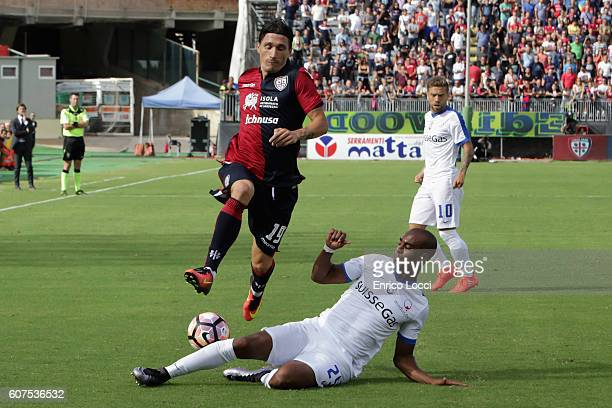 Contrast with Fabio Pisacane of Cagliari and Addoulay Konko of Atalanta during the Serie A match between Cagliari Calcio and Atalanta BC at Stadio...