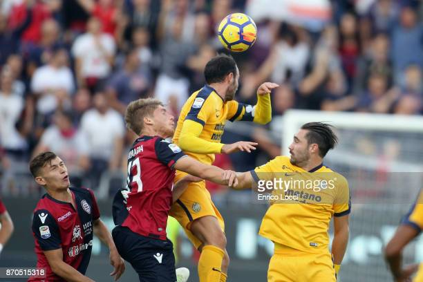Contrast with FIlippo Romagna of Cagliari and Giampaolo Pazzini of Verona during the Serie A match between Cagliari Calcio and Hellas Verona FC at...